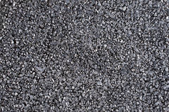 Shiny gravel texture, close up, background use. Royalty Free Stock Photography