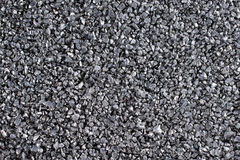 Shiny gravel texture, close up, background use. Stock Image
