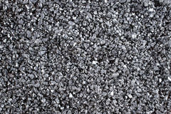 Shiny gravel texture, close up, background use. Royalty Free Stock Photo