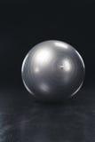 Shiny gray fitness ball Stock Photos