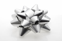 Shiny gray paper ribbon gift bow Stock Photo