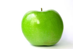 Shiny Green Apple. On a white background to show natural health and vitality gained from eating fruit Royalty Free Stock Photos