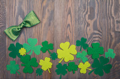 Shiny green bow and clover leaves traditional Irish decoration Stock Photo