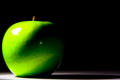 Shiny green Granny Smith apple Royalty Free Stock Image