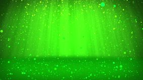 Shiny green particles or glitters fall and settle on the surface. Background or place for your objects, advertisement or