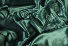 Shiny green satin fabric Stock Photos