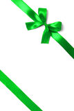 Shiny green satin ribbon on white background Royalty Free Stock Photography