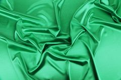 Shiny green silk background. Stock Image