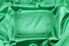 Shiny green silk background. Stock Images