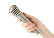 Shiny grey iron microphone in hand Royalty Free Stock Photography