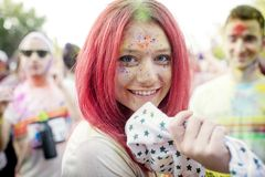 Shiny Happy Girl at The Color Run Bucharest royalty free stock image