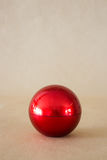 Shiny hard red ball on brown background Stock Photography