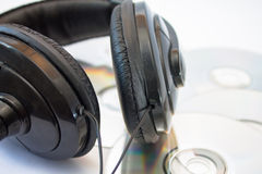 Shiny Headset with compact discs Royalty Free Stock Photography