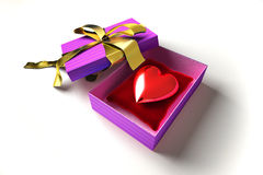 Shiny heart in a gift box, on a white surface. Royalty Free Stock Images