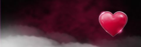 Shiny heart glowing with purple misty background. Digital composite of Shiny heart glowing with purple misty background Stock Image