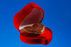 Shiny heart in a jewellery box Royalty Free Stock Image