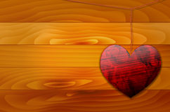 Shiny heart on the rope and wooden background Stock Images