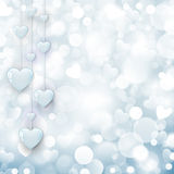 Shiny hearts on blue background Stock Photos