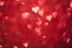 Shiny hearts bokeh Stock Image