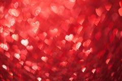 Shiny hearts bokeh Stock Images