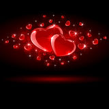 Shiny Hearts on dark background Royalty Free Stock Image