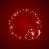 Shiny hearts on red background Stock Photos