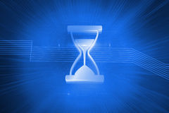 Shiny hourglass on blue background Royalty Free Stock Photos