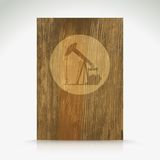 Shiny icon with brown design on wooden background Stock Photos