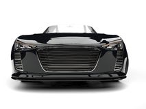 Shiny jet black modern cabriolet super car - front view closeup shot Royalty Free Stock Photography