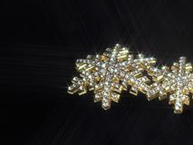 Shiny jewellery in dark back Royalty Free Stock Photo