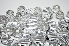 Shiny Jewels. Pile of shiny jewels on light background royalty free stock photography