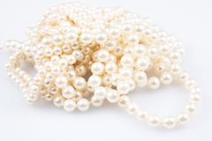 Shiny jewerly white pearl beauty in white background. A shiny jewerly white pearl beauty in white background royalty free stock photo