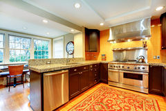 Shiny kitchen with black wood cabinets Stock Photos