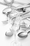 Shiny kitchenware. Shiny fork and glass and spoons Stock Photography