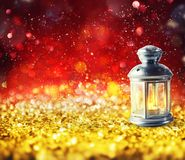 Shiny lantern on a Christmas sparkle background. Shiny lantern on a Christmas background with light effects vector illustration