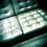 Shiny leather sofa Stock Images