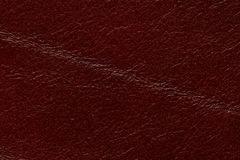 Shiny leather texture with contrast dark red surface. High resolution photo royalty free stock photo