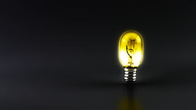 Shiny light bulb on black background,leave space for text conten Royalty Free Stock Photo