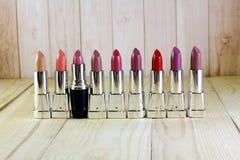 Shiny lipstick and one black Royalty Free Stock Photo