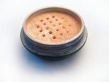 Shiny Makeup Powder. Macro of shiny makeup powder on white background Royalty Free Stock Images