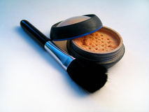Shiny Makeup Powder II with Brush. Opened shiny makeup powder with brush laying next to it stock photo