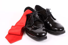 Shiny men's dressy shoes and red tie Royalty Free Stock Photography