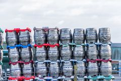Shiny metal beer kegs barrels of beer stacked for dispatch Royalty Free Stock Photography