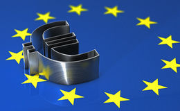Shiny metal euro symbol lying on the european flag Royalty Free Stock Image