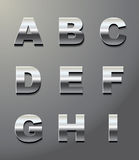 Shiny metal letters Stock Images