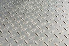 Shiny Metal Pattern. Bumpy metal pattern at angle royalty free stock photo