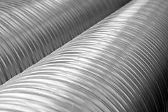Shiny metal pipes Stock Images