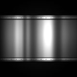 Shiny metal plate on carbon fibre background Royalty Free Stock Images