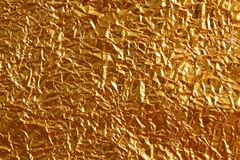 Shiny metal yellow golden texture background. Metallic gold patt Royalty Free Stock Photography