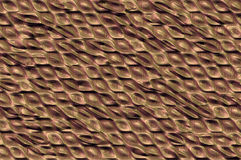 Shiny metallic cells texture - bronze. Abstract textured metallic background with the shiny cells relief pattern Royalty Free Stock Photography